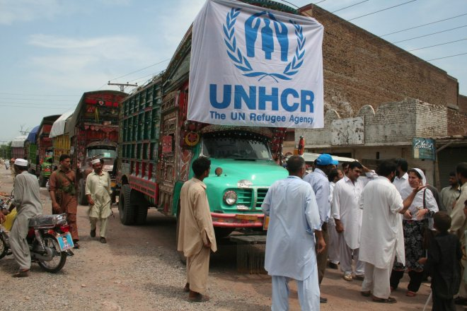Pakistan / floods / A convoy of UNHCR trucks loaded with relief items for flood survivors in the district of Sibi, in Balochistan, western Pakistan. / UNHCR / D.A Khan / July 2010